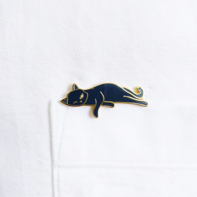 Bounty the Cat enamel pin on shirt