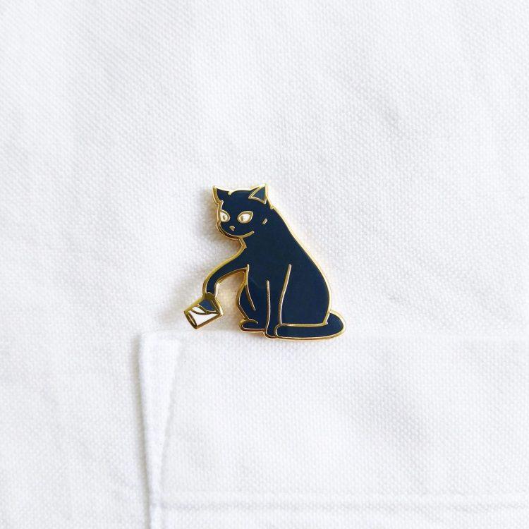Bounty the Cat enamel pin on shirt