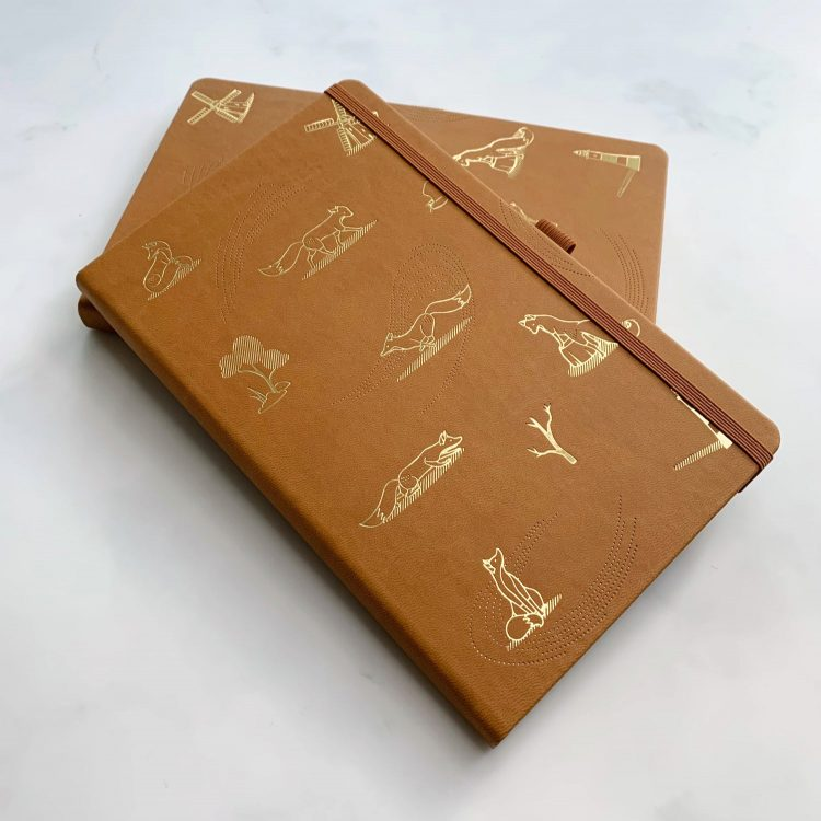 Quinn the Fox Headwinds blustery chestnut notebook stacked
