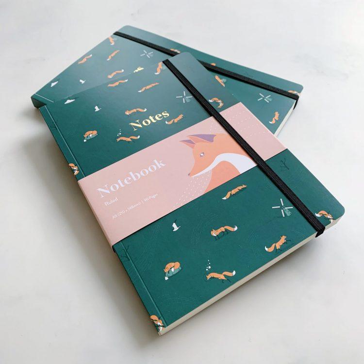 Quinn the Fox Headwinds summer rain green A5 softback notebook stacked